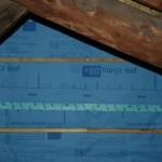 Une membrane de frein vapeur posee sur un mur en ossature bois